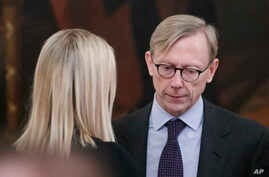 Ivanka Trump, left, the daughter and assistant to President Donald Trump, talks with Brian Hook, U.S. special representative…