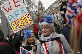 Brexiteers celebrate in London, Friday, Jan. 31, 2020. Britain officially leaves the European Union on Friday after a…