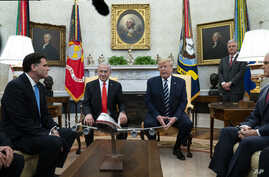 President Donald Trump speaks during a meeting with Israeli Prime Minister Benjamin Netanyahu in the Oval Office of the White…