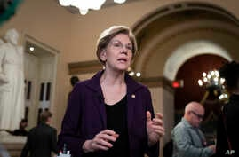 Sen. Elizabeth Warren, D-Mass., speaks during a television news interview during a break in the impeachment trial of President…