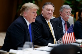 Secretary of State Mike Pompeo, center, and national security adviser John Bolton, right, listen as President Donald Trump…