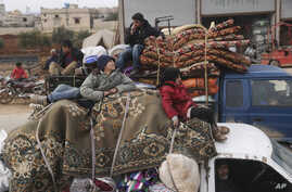 Syrian refugees head northwest through the town of Hazano in Idlib province as the flee renewed fighting Monday, Jan. 27, 2020…