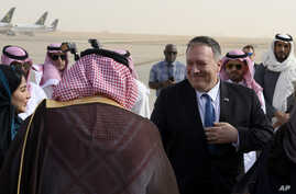 US Secretary of State Mike Pompeo, right, is met by a member of Saudi protocol as he arrives at the King Khalid International…