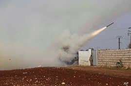 Turkish soldiers fire a missile at Syrian government position in the province of Idlib, Syria, Friday, Feb. 14, 2020. Turkey,…