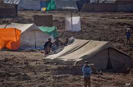 This Monday, Jan. 19, 2015 photo, shows Pakistani refugees at Gulan camp, some 20 kilometers (12 miles) from the border in the…