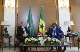 US Secretary of State Mike Pompeo, left, speaks with Senegalese President Macky Sall, during their meeting at the Presidential…