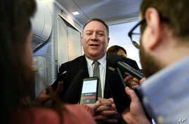 Secretary of State Mike Pompeo takes questions from reporters during a flight from Andrews Air Force Base, Md., to Germany on…