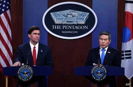 Defense Secretary Mark Esper, left, South Korean National Defense Minister Jeong Kyeong-doo, right, speak during a news…
