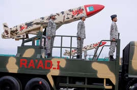 A Pakistani-made Cruise missile Ra'ad is loaded on a trailer rolls down during a military parade to mark Pakistan National Day,…