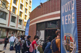 Voters wait on line at a polling station at the University of Southern California on Tuesday, March 3, 2020. Some California…