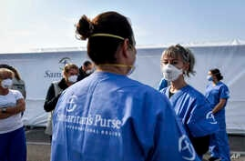 Staff at work at the Samaritan's Purse field hospital that is being set up in Cremona, northern Italy, Friday, March 20, 2020…