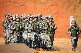 """In this photo released by China's Xinhua News Agency, Chinese soldiers attend a training session of the """"Hand in Hand 2008""""…"""