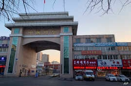 Businesses line the sides of the entrance of the port office in the Chinese city of Dandong bordering North Korea in…