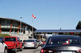 In this photo taken Oct. 9, 2019, traffic enters Canada from the United States at the Peace Arch Border Crossing, in Blaine,…