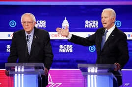 Democratic presidential candidates, Sen. Bernie Sanders, I-Vt., left, and former Vice President Joe Biden, right, participate…