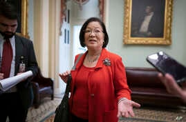 Sen. Mazie Hirono, D-Hawaii, talks to reporters after the Senate heard closing arguments in the impeachment trial of President…