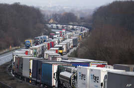 Trucks are jammed on the motorway A4  near Bautzen, Germany, Tuesday, March 17, 2020. Because of the controls at the border…