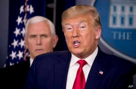 President Donald Trump, accompanied by Vice President Mike Pence, speaks about the coronavirus during a news conference in the…