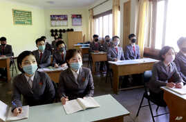 Students wearing face mask attend the class as their university reopened following vacation, at Kim Chaek University of…