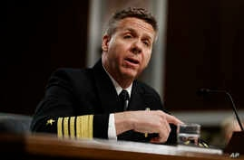 Navy Adm. Philip Davidson testifies during a Senate Armed Services Committee hearing on Capitol Hill in Washington, Tuesday,…