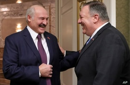 Belarusian President Alexander Lukashenko, left, and U.S. Secretary of State Mike Pompeo smile as they talk to each other…
