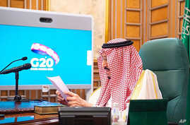 In this photo released by Saudi Press Agency, SPA, Saudi King Salman, chairs a video call of world leaders from the Group of 20…