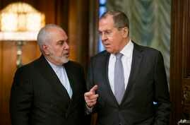 Russian Foreign Minister Sergey Lavrov, right, and Iranian Foreign Minister Mohammad Javad Zarif enter a hall for their talks…