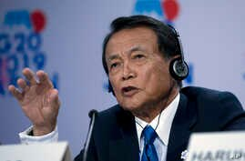 Japan's Finance Minister Taro Aso speaks during a news conference in the sidelines of the World Bank/IMF Annual Meetings in…