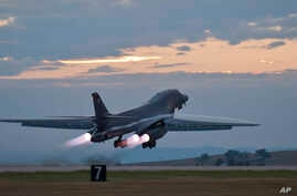 This July 24, 2012 photo provided by the U.S. Air Force shows a B-1 bomber rumbling down the flightline at Ellsworth Air Force…