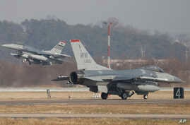 U.S. Air Force F-16 fighter jets take part in a joint aerial drills called Vigilant Ace between U.S and South Korea, at the…