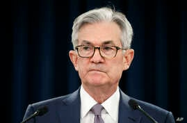 FILE - In this March 3, 2020 file photo, Federal Reserve Chair Jerome Powell pauses during a news conference in Washington. …