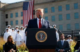 President Donald Trump speaks during a ceremony honoring the victims of the Sept. 11 terrorist attacks, Wednesday, Sept. 11,…