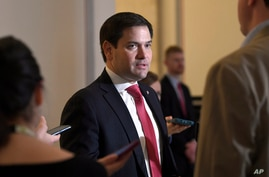Sen. Marco Rubio, R-Fla., talks to reporters before attending a Republican policy lunch on Capitol Hill in Washington, Friday,…