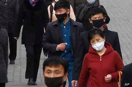 People wear face mask amid the concern over the spread of the coronavirus in Pyongyang, North Korea, Wednesday, April, 1, 2020…