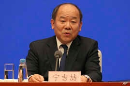 Ning Jizhe, Vice Chairman of National Development and Reform Commission, speaks during a press conference on the trade deal…