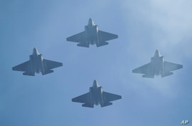 U.S. Navy F-35 jets fly over Levi's Stadium during the national anthem before an NFL divisional playoff football game between…