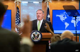 Secretary of State Mike Pompeo speaks during a press briefing at the State Department on Wednesday, May 20, 2020, in Washington…