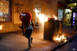 A protester in an Elmo mask dances during the Justice for George Floyd Philadelphia Protest on Saturday, May 30, 2020…