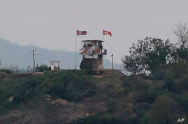 A North Korean flag flutters in the wind at a military guard post in Paju, at the border with North Korea, Sunday, May 3, 2020…