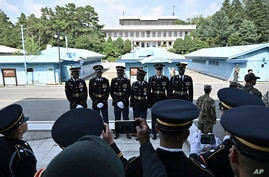 A United Nations Command honor guard prepares to pose for a photo at the truce village of Panmunjom in the Demilitarized Zone …