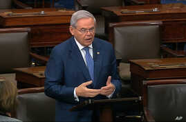 In this image from video, Sen. Robert Menendez, D-N.J., speaks on the Senate floor about the impeachment trial against…