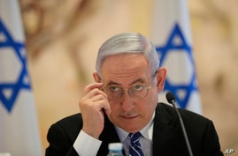 Israeli Prime Minister Benjamin Netanyahu attends the first Cabinet meeting of the new government at the Chagall Hall in the…