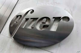 This Monday, Dec. 4, 2017, photo shows the Pfizer company logo at the company's headquarters in New York.  Pfizer said, Tuesday…