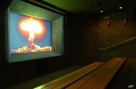 FILE - This Friday, Feb. 11, 2005 file picture shows an image of a mushroom cloud at the ground zero theater of the Atomic…