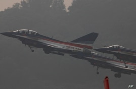 Chinese-made J-10 jet fighters take off for a demonstration at the 8th China International Aviation and Aerospace Exhibition …