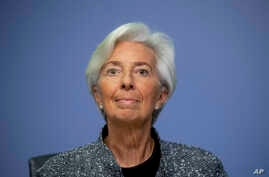 FILE -- In this Thursday, March 12, 2020 file photo the President of European Central Bank Christine Lagarde looks up prior to…