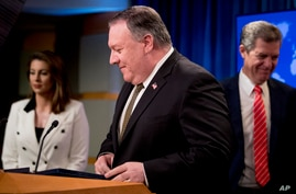 Secretary of State Mike Pompeo, accompanied by State Department spokeswoman Morgan Ortagus, left, and Sam Brownback, Ambassador…