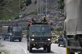 An Indian army convoy moves on the Srinagar- Ladakh highway at Gagangeer, north-east of Srinagar, India, Wednesday, June 17,…