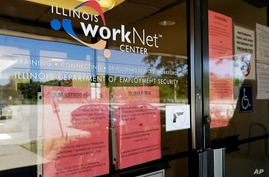 Information signs are displayed at the closed  Illinois Department of Employment Security WorkNet center in Arlington Heights,…