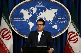 FILE - In this May 28, 2019 file photo, Iran's Foreign Ministry spokesman Abbas Mousavi speaks at a media conference in Tehran,…